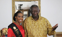 Yaba in a pose with former President John Agyekum Kufuor