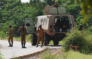File photo: Burkinabe soldiers patrol near the Presidential Security Regiment military barracks