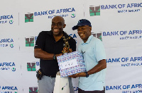 Managing Director of Bank of Africa, Kobby Andah presenting the prize to the Men's Category A winner
