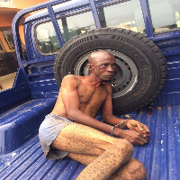 The suspect at the back of a Police pickup