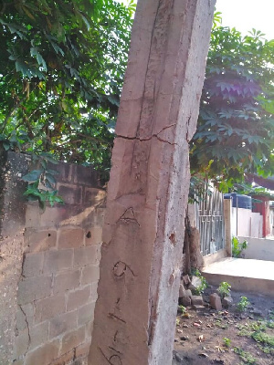 The almost-fallen concrete pole had multiple visible cracks exposing its age-long rusty iron rods
