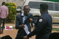 Sekyi Brown in an altercation with a police officer