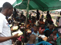 The group feeding some kayaye at Agbogbloshie during the 'Save a street child' event