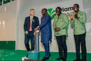 Dr. Mahamudu Bawumia flanked by officials of Olam Ghana
