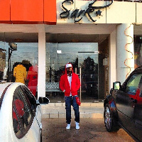 Sarkodie infront of the his shop