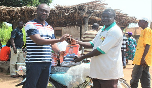 The Assemblyman (in stripped lacoste) handing the items to the  Landlord of Namolo