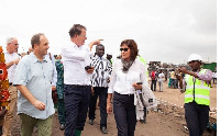 Dr. Müller (M), German Federal Minister of Economic Development with some dignitaries at the site