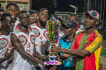 Mr Samuel Ofosu of SSNIT presenting the Youth trophy to Real Ambassadors players