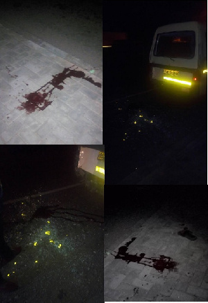 Blood from the injured and shattered glass from the bus, pictured at the scene