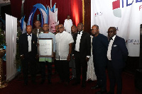 Some officials from Ideal Groupe with the award