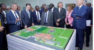 Eni officials and Senior Minister, Yaw Osafo-Marfo (M) in a group photograph