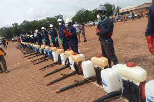 A team of workers preparing for a disinfection exercise