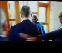 Stan Dogbe seen shoving the Scottish journalist from President Mahama