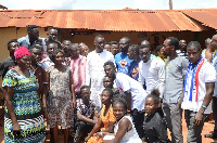 Group photo of beneficiaries with the minister