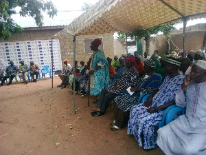 Robert Danpare, the Kassena-Nankana West District Director of NCCE speaking to the people