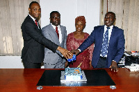 Executives of Delta Capital Ltd cutting a cake to mark their 3rd anniversary