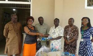 Mr Kobla Quashie, Consul to Swaziland donating to Korle Bu