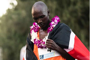 Kenya's Vincent Yator reflects after finishing third in Sunday's Honolulu Marathon in Hawaii, USA.