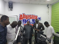 Officials of the EIB Network in a prayer with Kwame Adinkrah