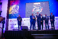 Dr. Mahamudu Bawumia presenting the award to the officials of Fidelity Bank