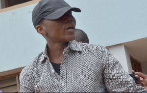 Gregory Afoko Wears Cap