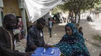 A woman casts her ballot at a roadside polling station in N'djamena