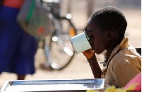 Child drinks water from a cup.       File photo.