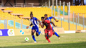 Accra Great Olympics and Asante Kotoko in a hard tackle for the ball