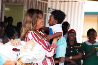 US First Lady Melania Trump holding a baby during her visit to the Ridge Hospital