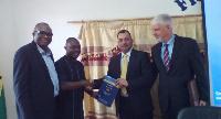 Prof Ransford Gyampo receiving the report from EU Chief Observer Tamas Mezerics