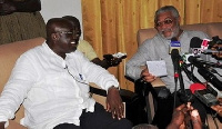 Rawlings (r) addressing the media in the presence of Akufo-Addo (l)