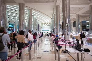 Travellers at the Dubai International Airport