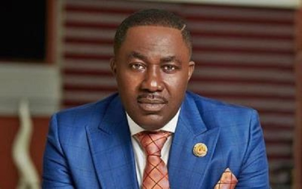 Dr. Osei Kwame Despite walks his daughter down the aisle