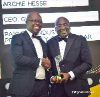 Archie Hesse recieving his award from Vice President Bawumia