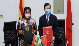 Madam Shirley Ayorkor Botchway, foreign minister, and Mr. Lu Kun, the Chinese Ambassador to Ghana.