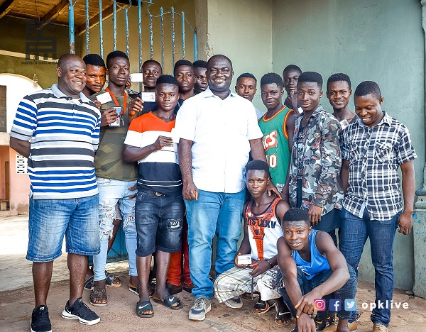 Davis Opoku Ansah (white shirt) in a group picture with some youth of Mpraeso