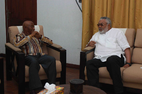 Outgoing Liberia Vice-President, Joseph Boakai (l) and Former President Rawlings (r)