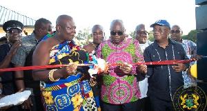 Torgbui Adzonugaga Amenya Fiti (L) and President Nana Akufo-Addo (R) cutting a ribbon