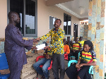 A rep from National Para-cycling team takes the donation
