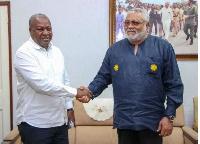 Former President John Dramani Mahama in a handshake with Former President Jerry John Rawlings