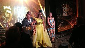 President Akufo-Addo receives his citation  at the GUBA Awards