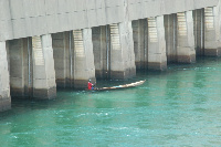 A fisherman fishing at the spillway