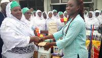 Hajia Mariama Obeng presenting the items to Madam Anita Essuman
