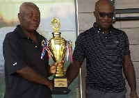 Atuwo (left) in a handshake with with Adu Jnr after receiving his prize