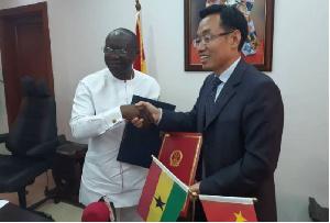 Ken Ofori-Atta and Chinese Ambassador Shi Ting Wang