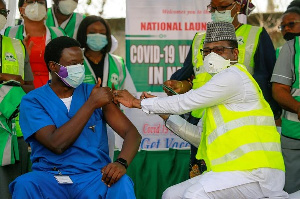 A man receives Nigeria's first COVAX jab in capital, Abuja