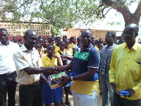 The NPP parliamentary candidate for Talensi, Thomas Duanab Wuni, presents textbooks to 32 schools