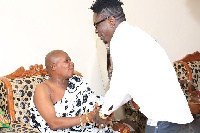 Dancehall King Shatta Wale exchanging pleasantries with a chief at Techiman.