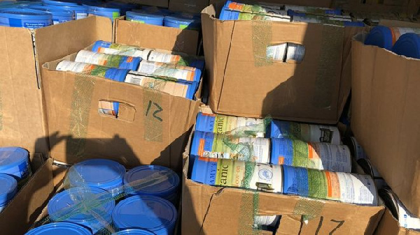 Australian police have seized thousands of tins of baby formula