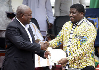 President Mahama receiving a presentation from GRA boss, George Blankson
